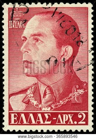 Luga, Russia - October 25, 2019: A Stamp Printed By Greece Shows Image Portrait Of Paul - King Of Gr