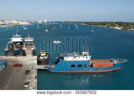 The View Of Cargo Ships Moored In Industrial Potters Cay With Nassau City On New Providence Island A