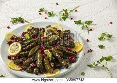 Stuffed Vine Leaves. Cherry And Lemon Leaf Wrapping, Stuffed. Traditional Turkish Stuffed Leaf Wrapp