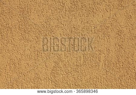 Yellow Wall, Texture, Background. Plastered Building Wall, Painted With Water-based Paint. Decorated