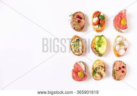 Assorted Bruschetta With Various Toppings.appetizing Bruschetta. Mix Bruschetta Variety Of Small San