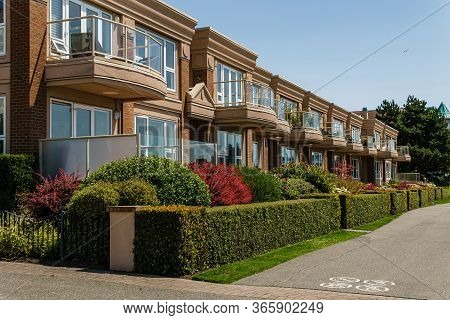 Victoria, Canada - July 14, 2019: Pathway In Front Of Residential Condo Building On Sunny Day With B