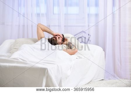 Guy On Painful Face Waking Up In Morning. Headache Concept. Macho With Beard And Mustache Suffers Fr