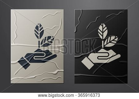 White Plant In Hand Of Environmental Protection Icon Isolated On Crumpled Paper Background. Seed And