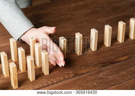 Business Woman Block Domino Effect. Business Assistance, Risk Management And Stabilisation Situation