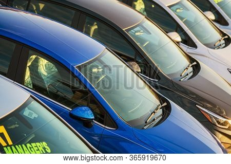 Close Up Of Multiple New And Used Vehicles For Sale At Car Dealership Lot.