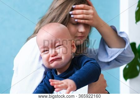 Mom Tired Trying To Calm Her Crying Baby. Newborn Tantrum Child On Mother Hands. Family Life, Mother