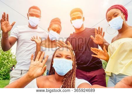 Group Of Five Friends Female And Male In Medical Mask Taking Selfie On Camera Smartphone And Having