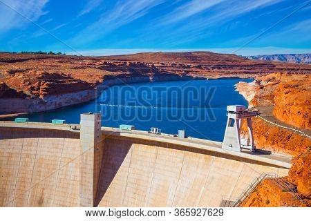 Glen Canyon Dam across the Colorado River. Humanity 's great creation is a dam across the Colorado River. Concept of active, ecological and photo toursm