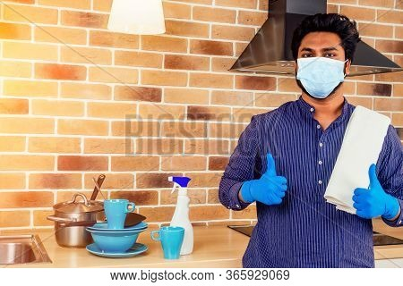 African Man In Medical Mask Cleaning Cooktop Cooker Hood At Home , Brick Wall With A Mountain Of Unw