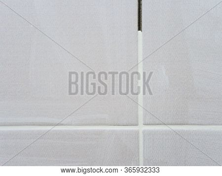 Repair In The Bathroom. Grouting Between Tiles