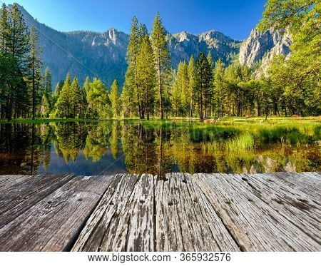 Cathedral Rocks reflecting in Merced River at Yosemite National Park. California, USA.