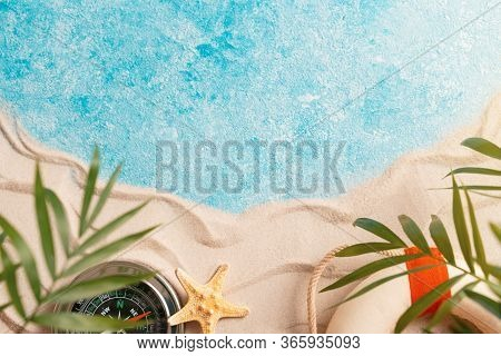 Vacation And Travel Concept, Flat Lay Top View Copy Space, Minimal Exotic Concept. Layout Of Sand Wa
