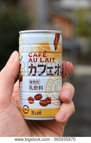 Tokyo, Japan - November 24, 2016: Person Holding Cheerio Brand Cafe Au Lait (blues Coffee) Canned Ho