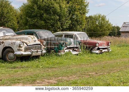 Mozhaisk, Russia - August 11, 2019: Old Abandoned Rusty Vehicles, Crushed Cars In Scrapyard, Junk Ya