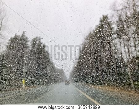 Rainy Weather On Highway, Rain Drops On The Windshield. Abstract Cars, Blurred Backdrop.dangerous Ve