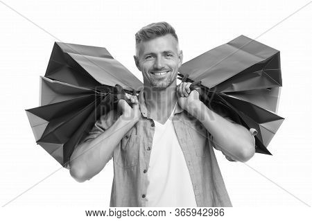 Avid Shopaholic. Happy Man With Packages After Shopping. Handsome Man Care Heavy Shopping Bags. Buy