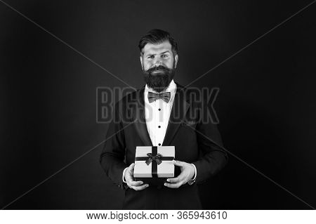 Gift Whatever You Want. Businessman With Gift Dark Background. Bearded Man Hold Gift Box. Boxing Day