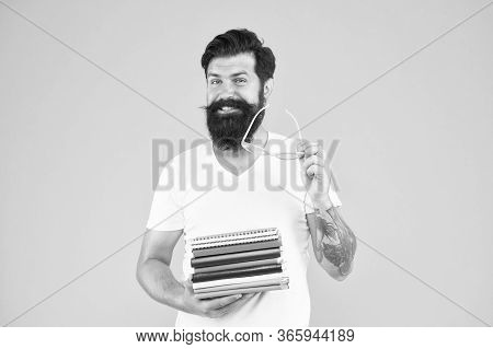 Clever Forever. Happy Student Yellow Background. University Student Hold Books. Smart Student Smile