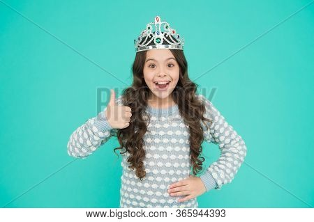 Super Girl. Happy Child Give Thumbs Up Blue Background. Little Princess Smile Gesturing Thumbs Up. A