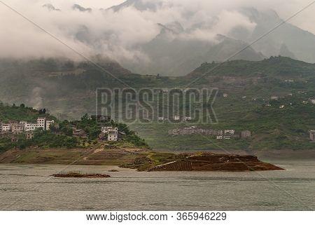 Xiangxicun, China - May 6, 2010: Xiling Gorge On Yangtze River. Landscape Under Along Green Mountain