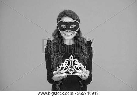 Make Your Prom Royalty Shine. Little Prom Queen In Carnival Mask. Small Child Hold Prom Crown. Coron