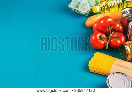 Food Donations On Green Background With Copyspace - Pasta, Fresh Vegatables, Canned Food, Baguette,