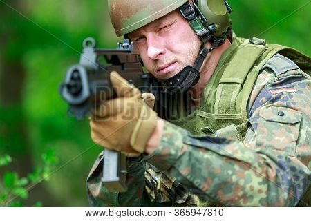 German Soldier With A German Assault Rifle