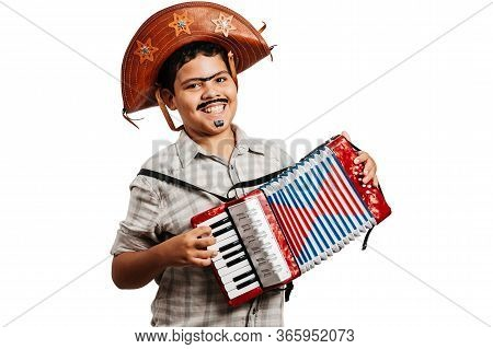 Brazilian Boy Wearing Typical Clothes For The Festa Junina - June Festival - Playing Toy Accordion