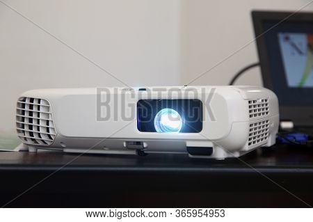 Lcd Video Projector At Business Conference Or Lecture In Office With Copy Space. Projector On Ceilin