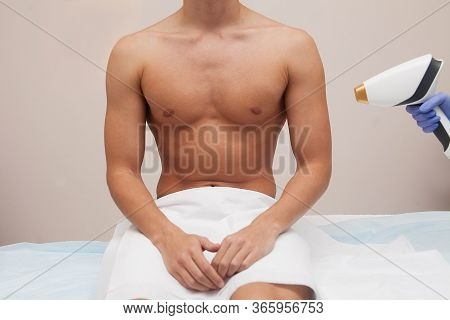 Muscular Athlete Man With Smooth Clear Skin. Epilation And Depilation Of Hair In Beauty Salon. Male