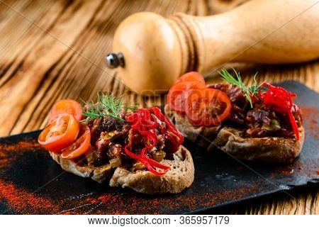 Set Of Different Bruschetta With Beef Tartare, Crostini With Beef Tartare And Rocket, Copy Space