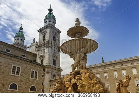 Horse Fountain In Front Of Cathedral In The Old Town Of Salzburg By Day, Austria