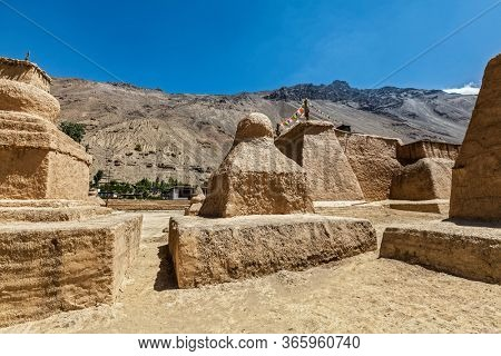 Buddhist Tabo monastery building and gompas made of clay in Tabo village Spiti Valley. Monastery is built on high Himalayan plateau in tradition of Tibetan Buddhism religion. Himachal Pradesh, India