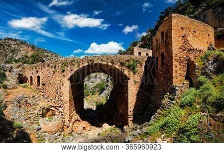 Riuns of abandoned Katholiko monastery church in Avlaki gorge, Akrotiri peninsula, Chania region on Crete island, Greece. Tracking shot