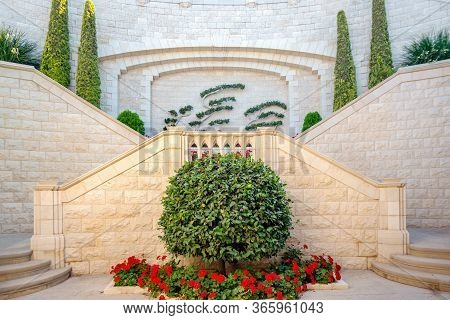Beautiful Installation In The Bahai Gardens. Two-way Stairs And Green Bushes With Flowers. Haifa, Is
