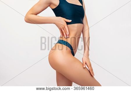 Unrecognizable Fit Woman In Black Lingerie On White Background Isolated. Muscular Slim Attractive Fe
