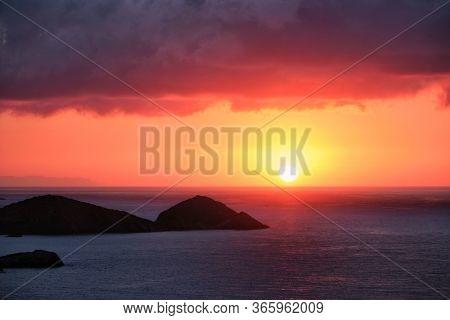 Sea sunset. Seascape sunset with island. Sun setting down in sea. Crete island, Greece
