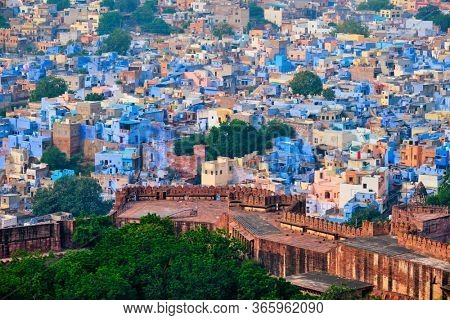 Aerial view of Jodhpur, also known as Blue City due to the vivid blue-painted Brahmin. View from Mehrangarh Fort (part of fortifications is also visible). Jodphur, Rajasthan, India