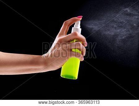 Woman's hand holding antibacterial spray