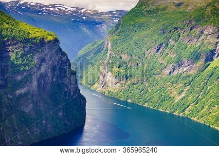 Tourism Vacation And Travel. Beautiful View Over Magical Geirangerfjorden From Ornesvingen Viewpoint