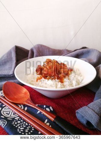 Asian style caramel pork with rice and vegetable