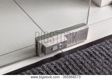 The Lock On The Glass Door, The Metal Mechanism Of Locking The Doors With The Keyhole On The Glass O