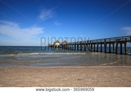 Naples, Florida, Usa - May 9, 2020: Empty Naples Pier After It Was Closed Off Due To The Covid 19 Vi