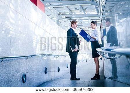 Male And Female Businessmen From Different Nationalities Stand Meeting Outside The Building. Entrepr