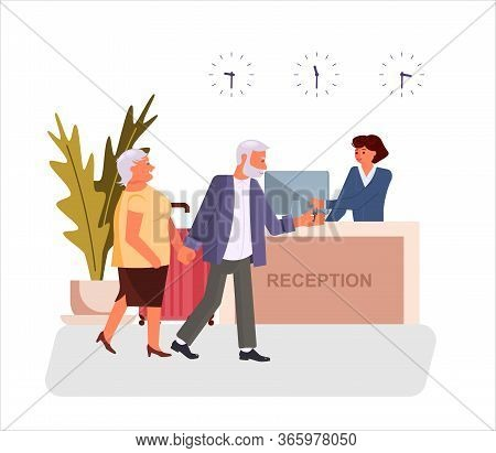 Hotel Receptionist Gives The Key To The Room To Pair Of Old Tourists Or Elderly Travellers. Scene Wi