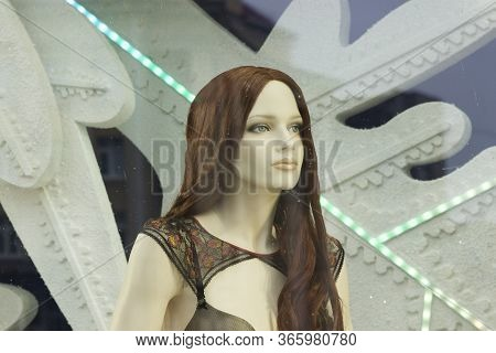 Girl Mannequin In A Shop Window. Long Hair, Makeup And Underwear.