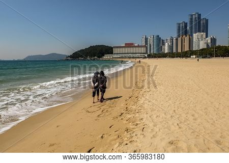 Busan, South Korea April 4, 2019: People Relaxing And Having Fun On Haeundae Beach.one Of The Famous