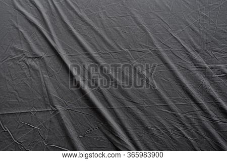 Abstract Pattern Of A Gray Crumpled Bed Sheet In Bedroom. Gray Wrinkled Fabric Texture Rippled Surfa