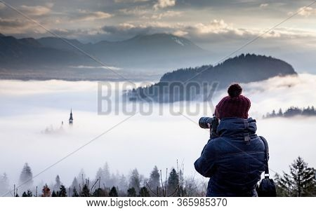 photographer woman taking photos of Bled island